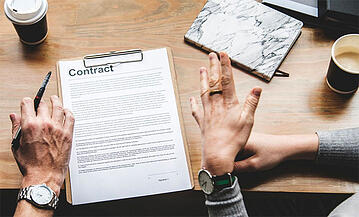 Home-buyer-signing-contract