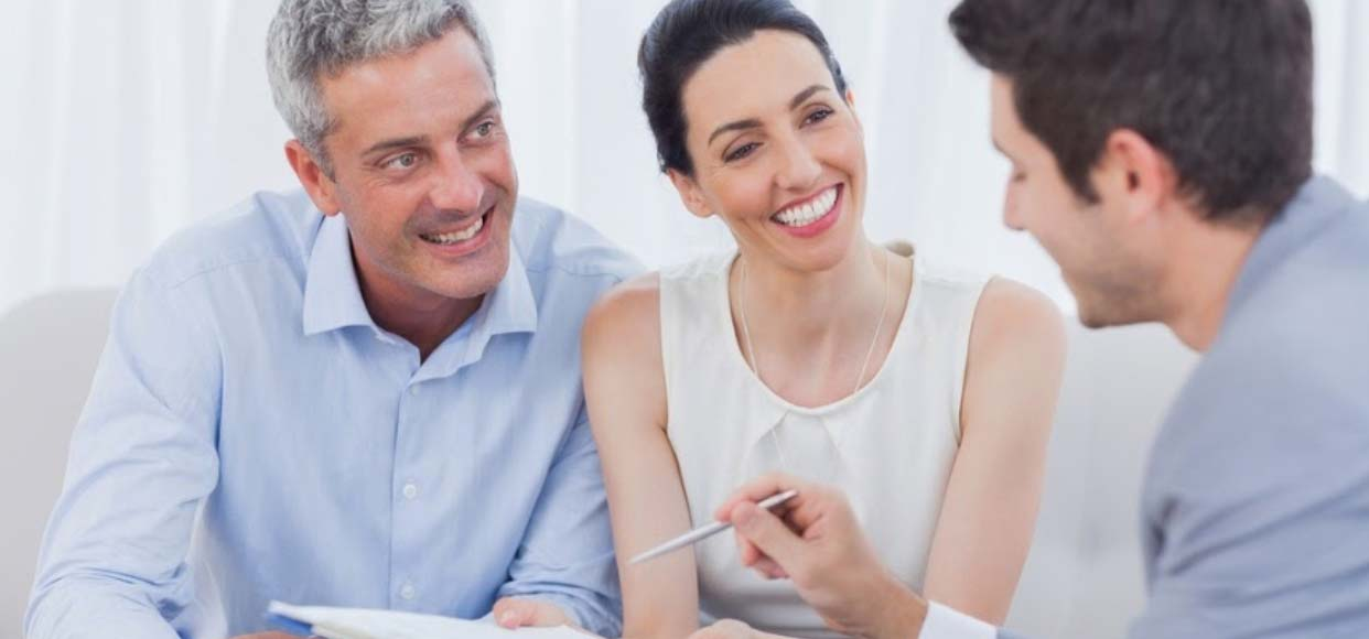 Middle aged couple meeting with an online sales consultant to buy a new home