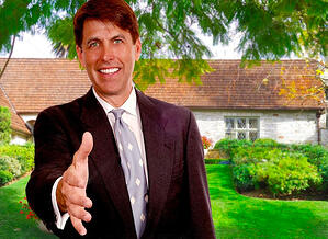 New home sales person reaching out to shake hands