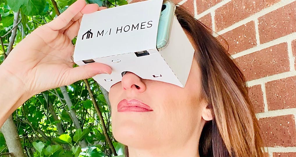 Woman-using-VR-with-phone-to-view-MI-home