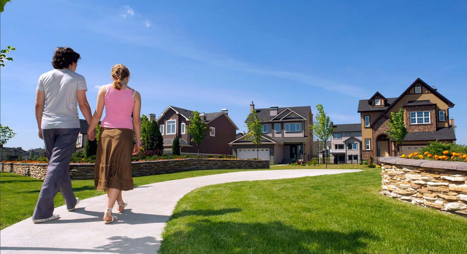 Young couple walking toward community selling new homes