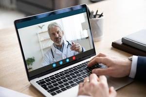 Computer screen showing doctor on webcam