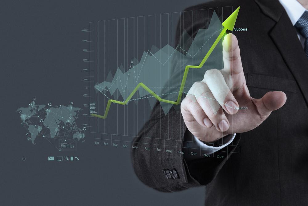businessman hand draws business success chart concept on virtual screen