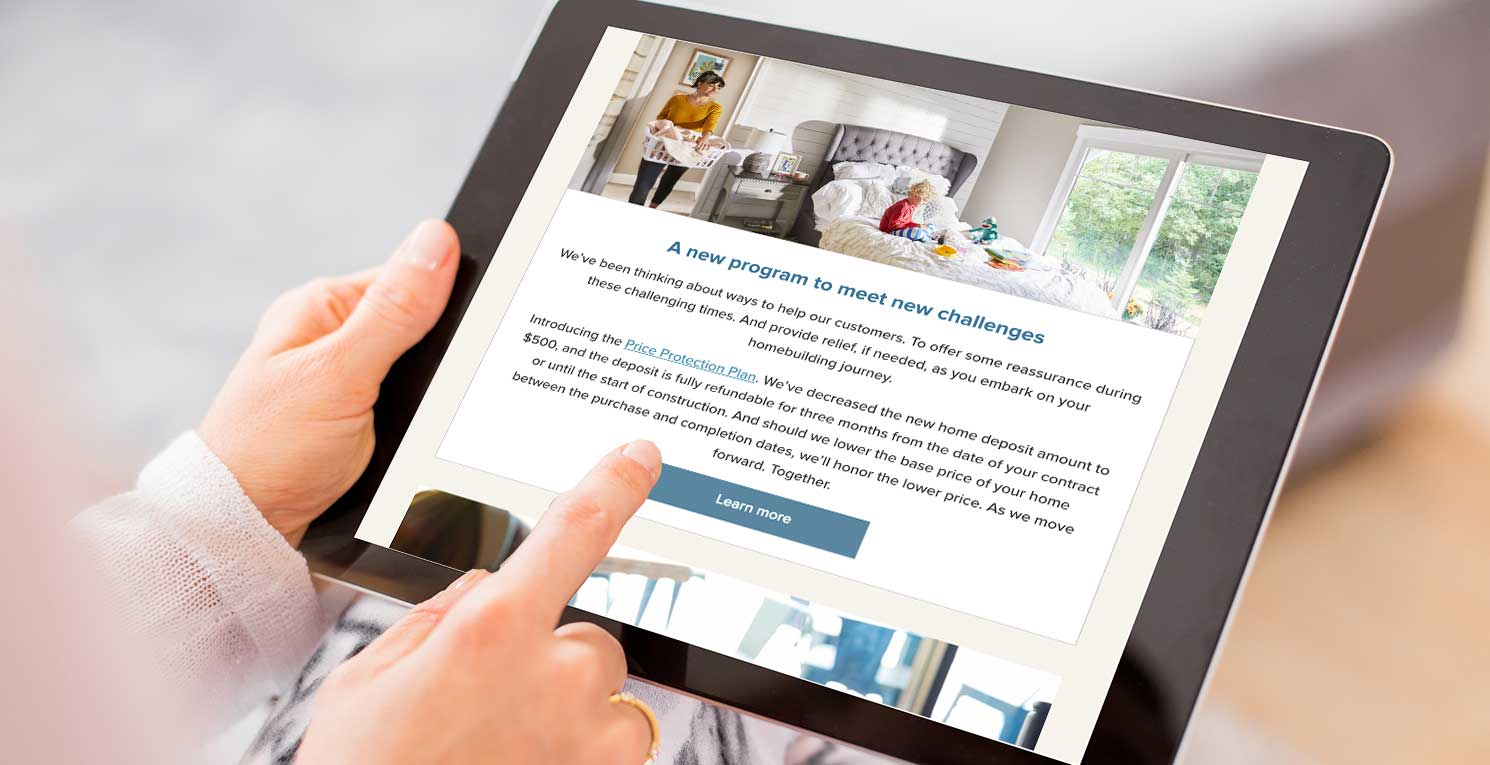 person on ipad looking at home builder email marketing strategy